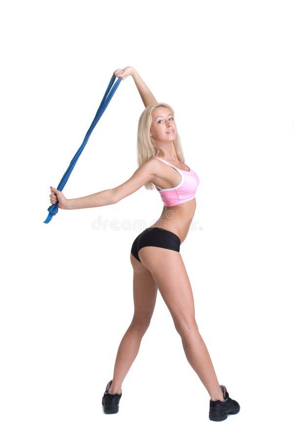 Mulher do esporte no fundo branco imagem de stock royalty free