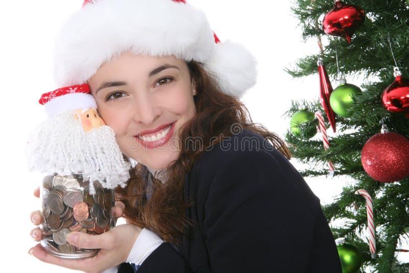 Mulher do Natal com dinheiro fotografia de stock