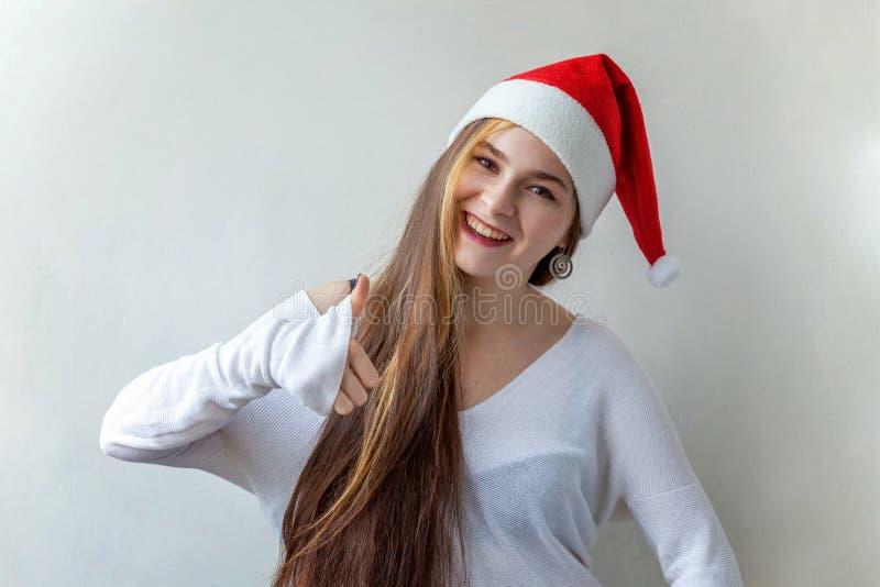 Mulher do Natal com polegar acima fotos de stock