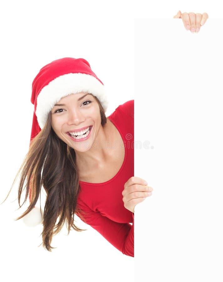 Mulher do Natal que mostra a bandeira do sinal imagens de stock
