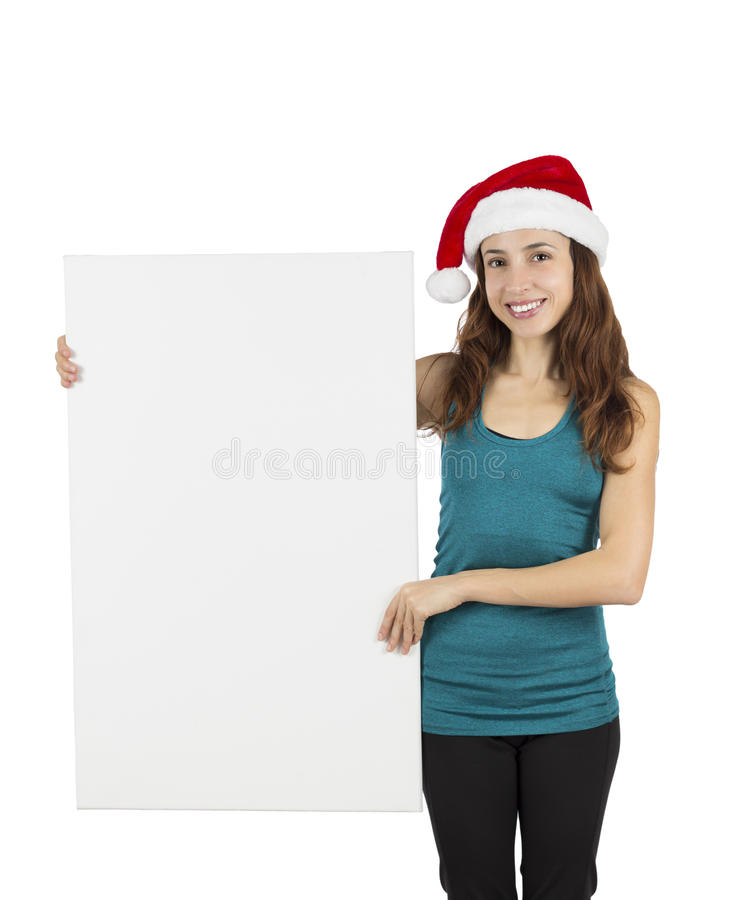 Mulher do Natal que mostra o cartaz vazio imagem de stock