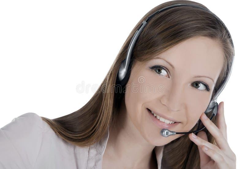 Mulher do operador do cliente com auriculares foto de stock