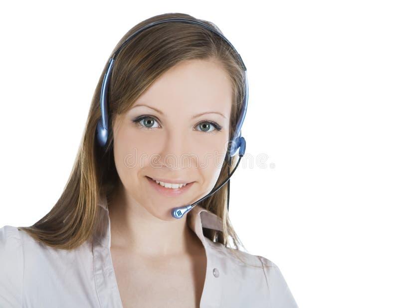 Mulher do operador do serviço de atenção a o cliente com auriculares fotografia de stock royalty free