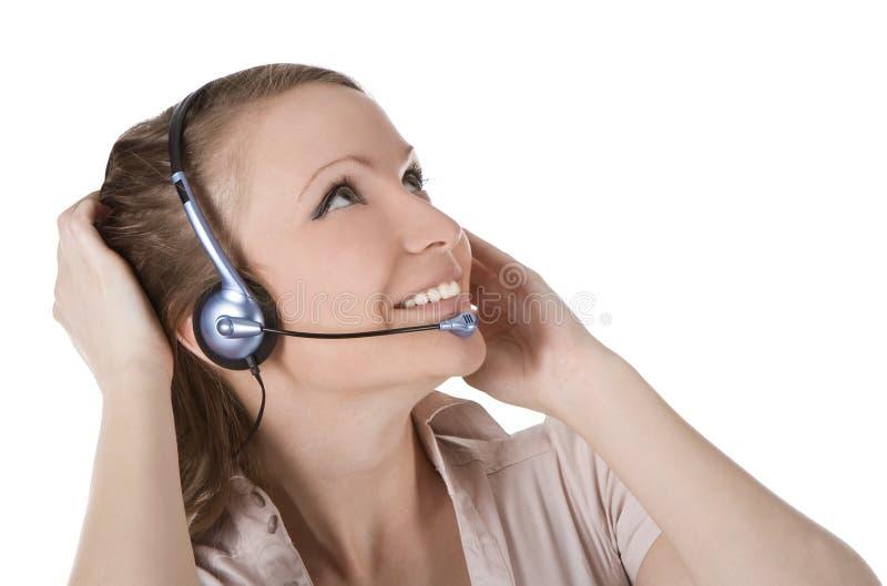 Mulher do operador do serviço de atenção a o cliente com auriculares fotos de stock