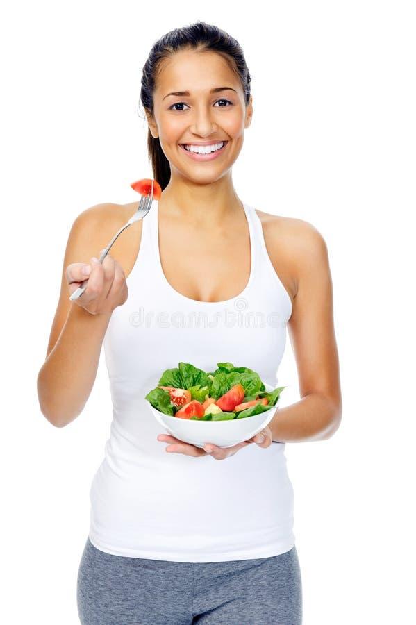 Mulher do petisco da salada fotografia de stock royalty free
