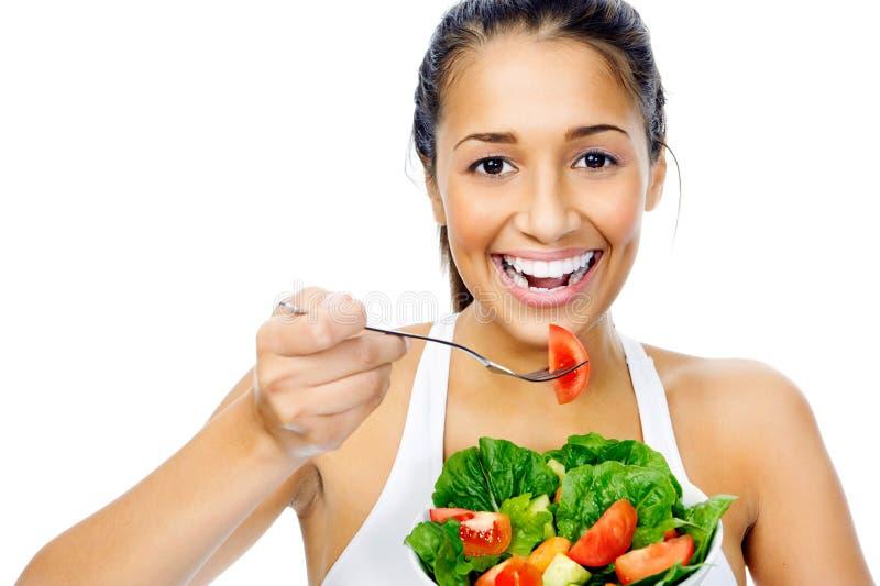 Mulher do petisco da salada fotografia de stock