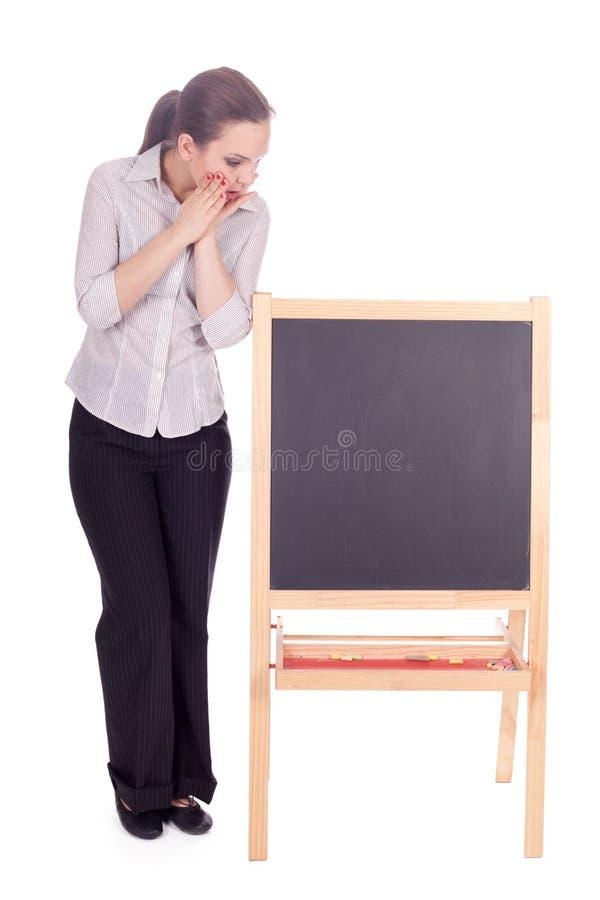 Mulher do professor com quadro-negro pequeno fotografia de stock