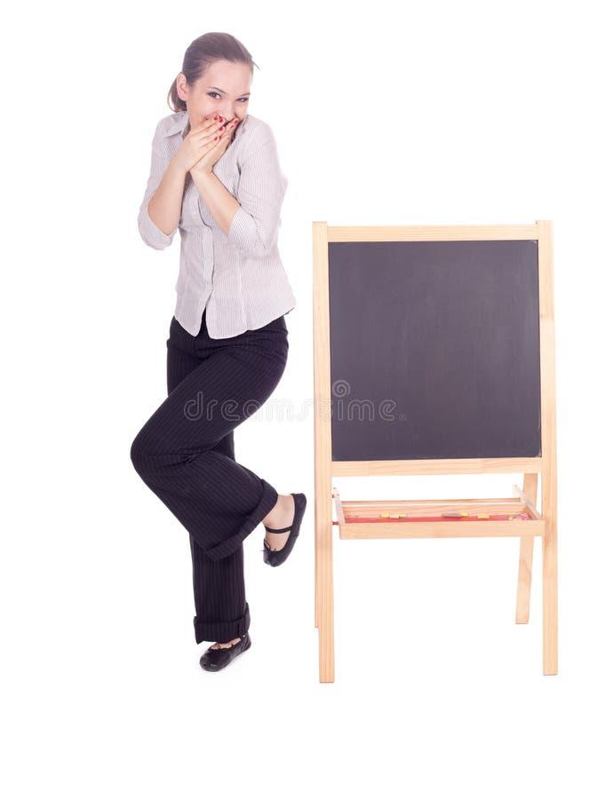 Mulher do professor com quadro-negro pequeno foto de stock