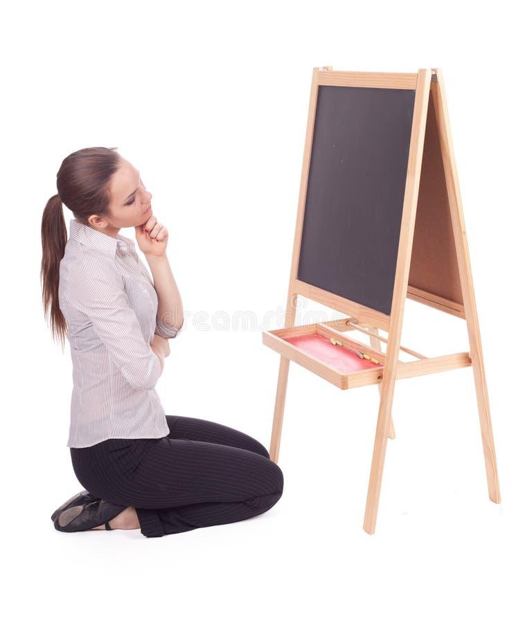 Mulher do professor com quadro-negro pequeno imagens de stock