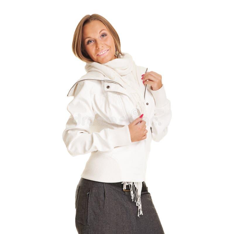 Mulher do smiley no revestimento branco fotografia de stock