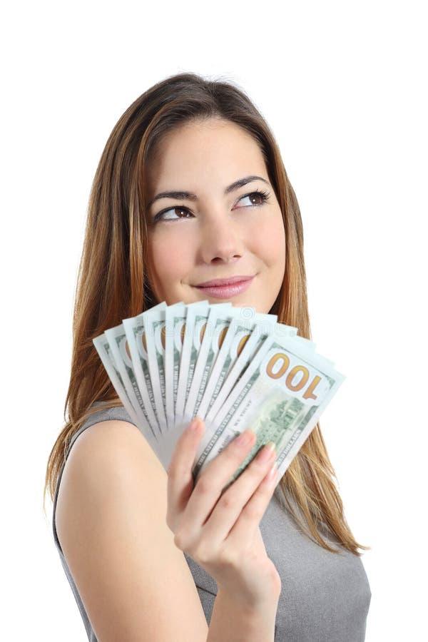 Mulher do vencedor de loteria que pensa que fazer com dinheiro fotos de stock royalty free