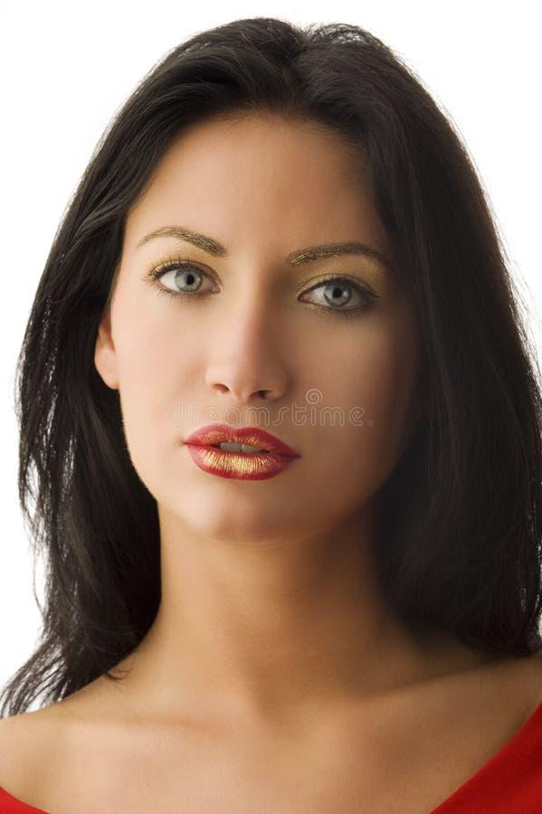 A mulher do vermelho e do ouro foto de stock