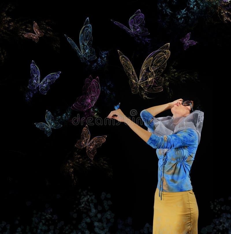 Mulher e borboletas fotos de stock