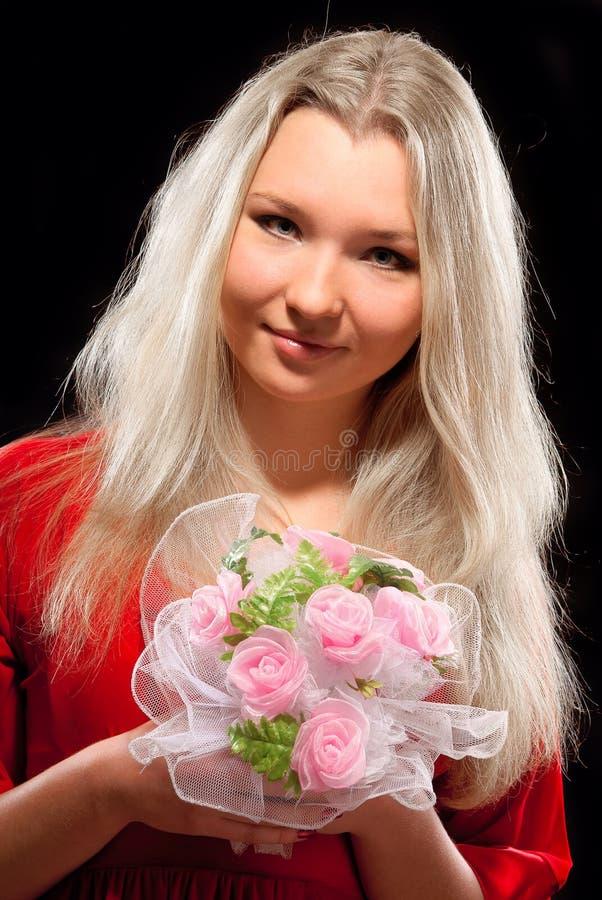 Mulher e flores imagem de stock