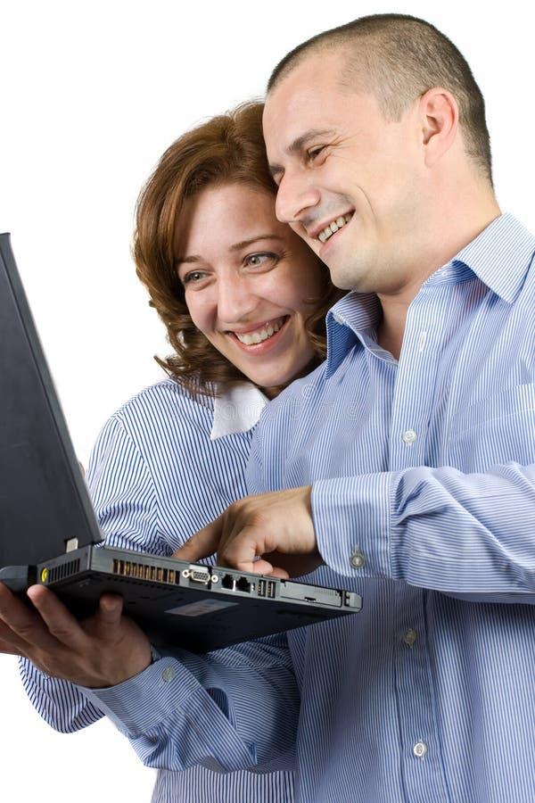 Mulher e homem de negócio que trabalham junto foto de stock