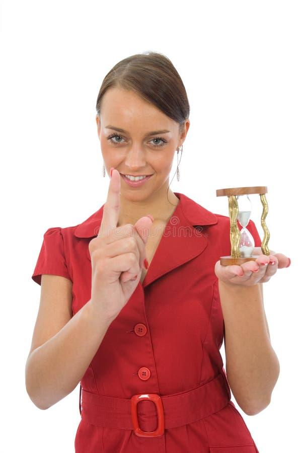 Mulher e hourglass imagem de stock royalty free