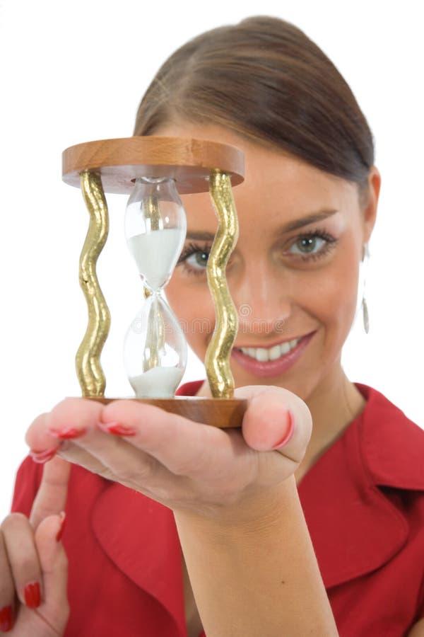 Mulher e hourglass imagem de stock