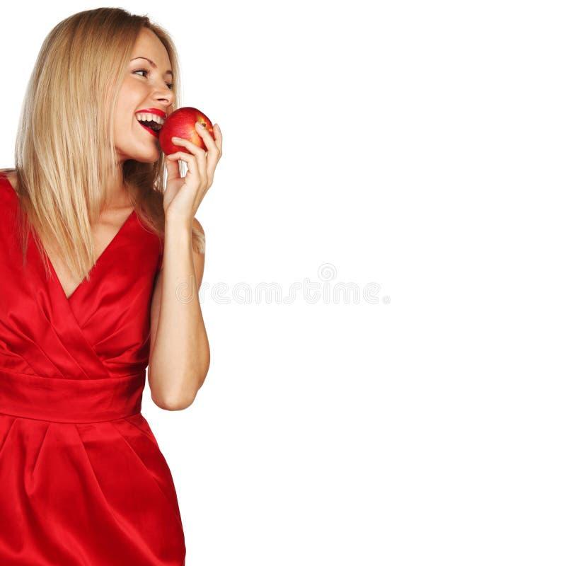 Mulher e maçã vermelha foto de stock