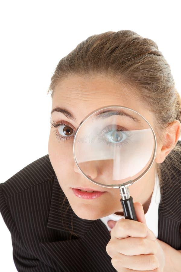 Mulher e magnifier foto de stock