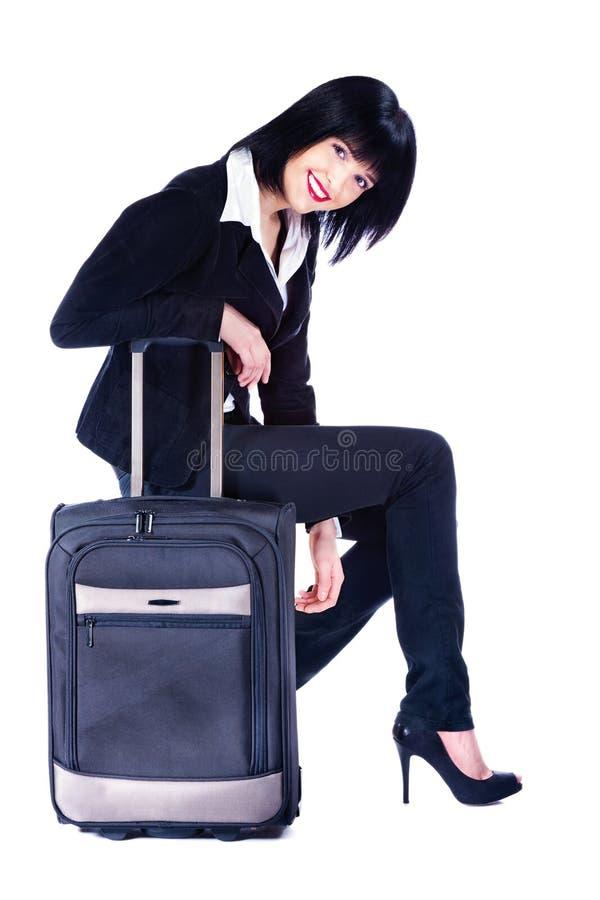 Mulher e mala de viagem, isoladas no branco fotografia de stock royalty free