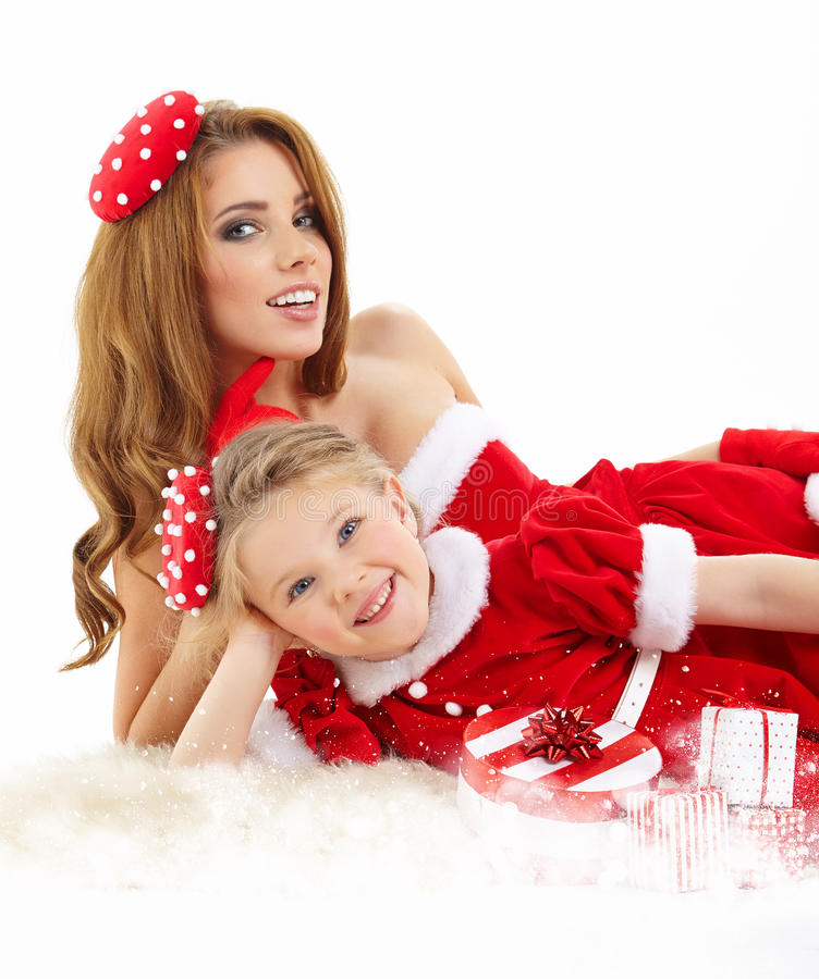 mulher e menina vestidas no traje Papai Noel imagens de stock royalty free
