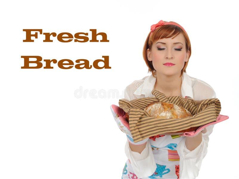 Mulher e pão de cozimento bonitos do chiabatta imagens de stock royalty free