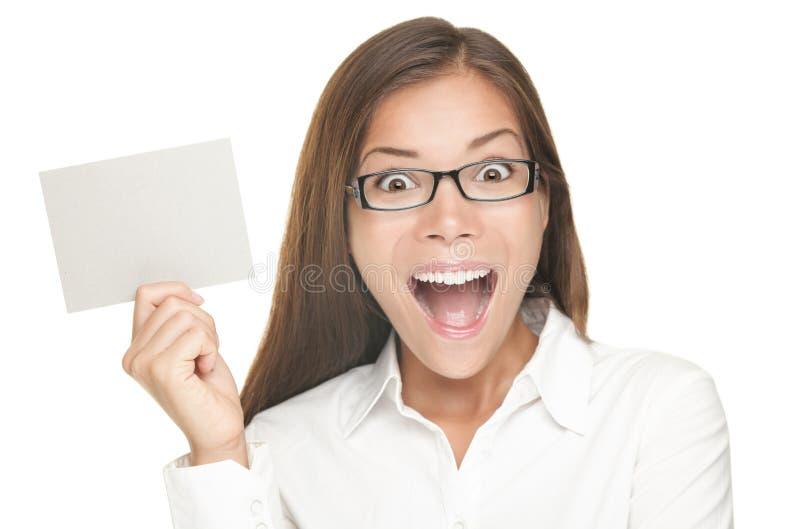 Mulher em branco do sinal excitada imagem de stock