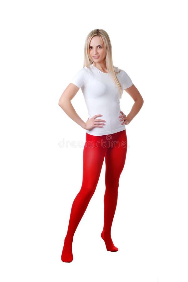 Mulher em calças justas vermelhas imagem de stock royalty free