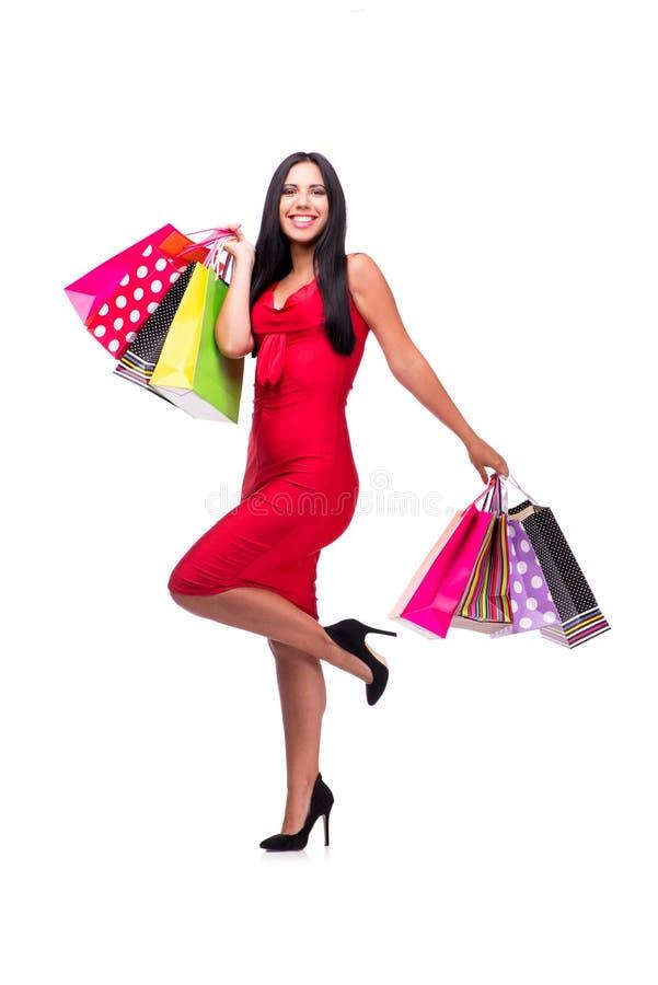 A mulher em dres vermelhos após a compra isolada no branco foto de stock