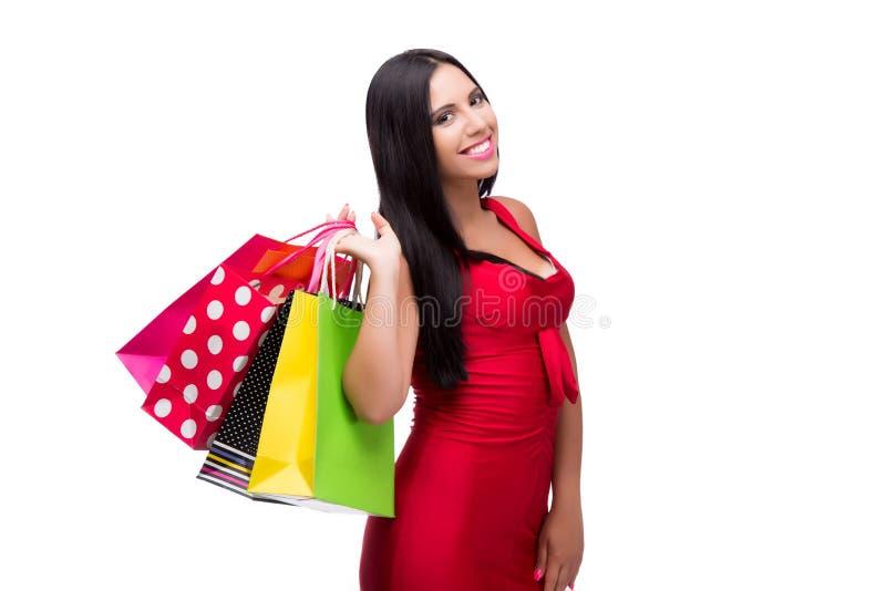 A mulher em dres vermelhos após a compra isolada no branco imagem de stock royalty free