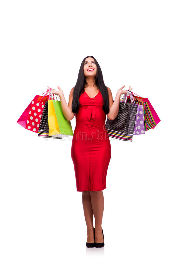 A mulher em dres vermelhos após a compra isolada no branco imagem de stock