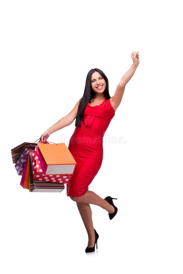 A mulher em dres vermelhos após a compra isolada no branco fotografia de stock