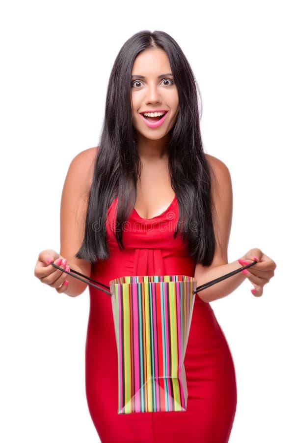 A mulher em dres vermelhos após a compra isolada no branco imagens de stock royalty free