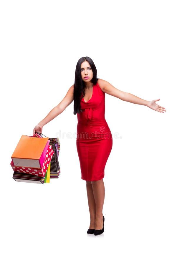 A mulher em dres vermelhos após a compra isolada no branco foto de stock royalty free