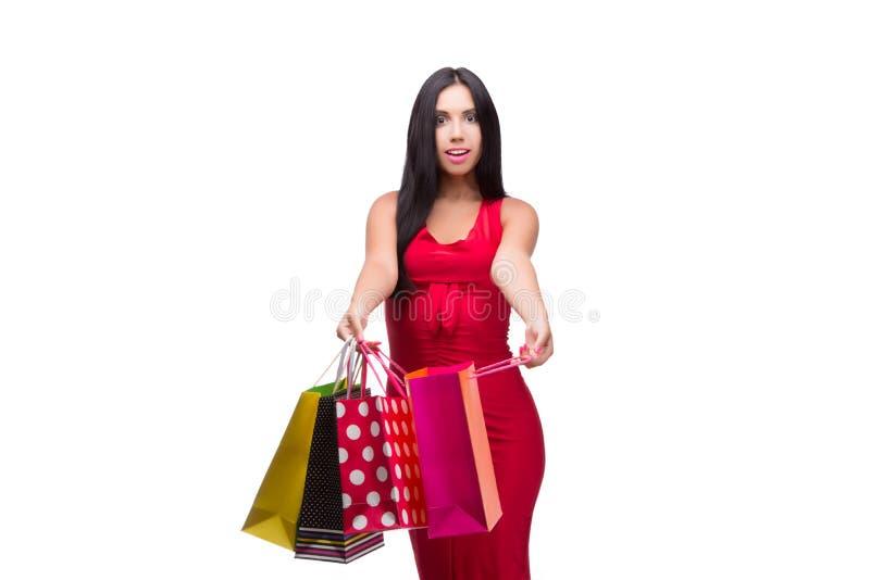A mulher em dres vermelhos após a compra isolada no branco fotos de stock royalty free