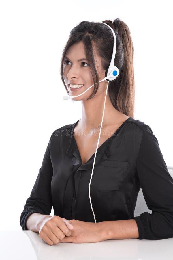 Mulher em um centro de atendimento - apoie o operador com uns auriculares, isolat fotografia de stock royalty free