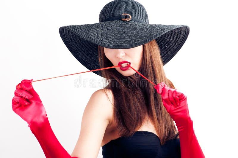 mulher em um chapéu isolado no fundo branco fotografia de stock