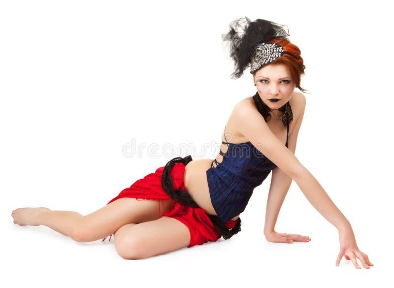 Mulher em um estilo do cabaré em um branco imagens de stock royalty free