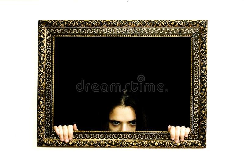 Mulher em um frame da pintura imagem de stock
