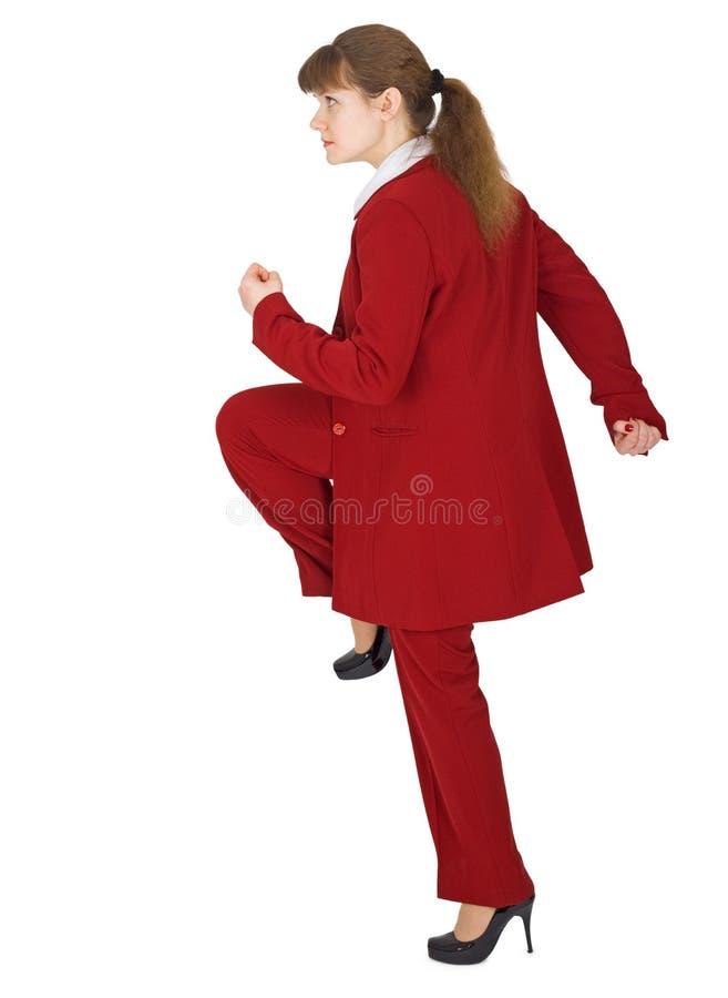 Mulher em um pose dinâmico no branco fotos de stock
