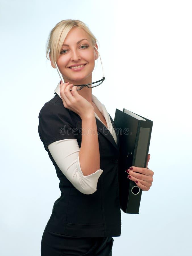Mulher em um terno com vidros imagens de stock royalty free
