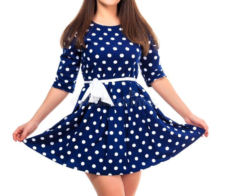 Mulher em um vestido com cópia do às bolinhas fotos de stock