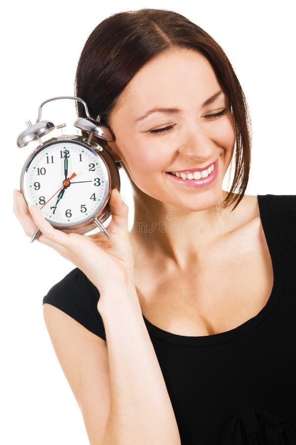 Mulher encantadora com despertador fotografia de stock royalty free