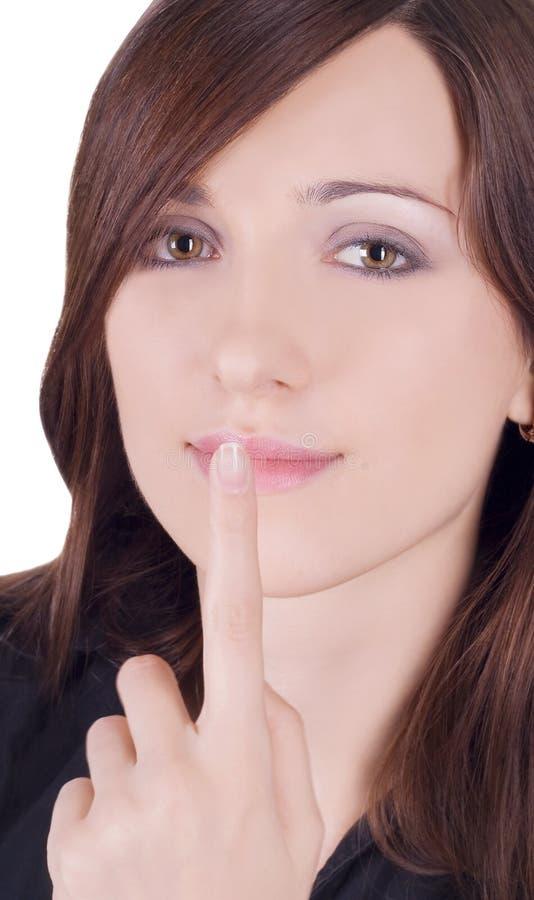 Mulher encantadora com o dedo nos bordos imagem de stock royalty free