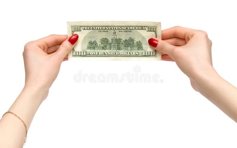 A mulher entrega o dólar da terra arrendada imagens de stock royalty free