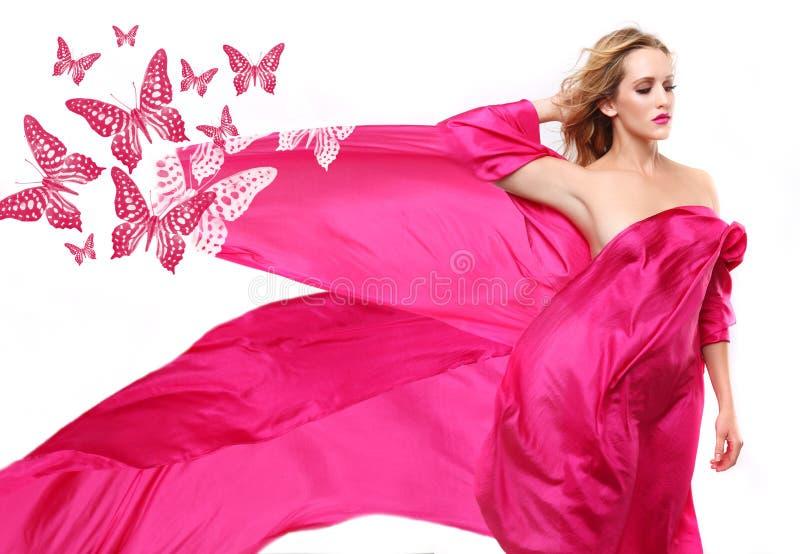 Mulher envolvida na tela de fluxo cor-de-rosa imagem de stock