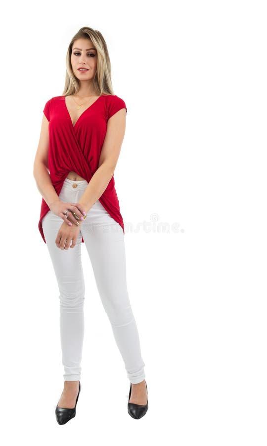 A mulher está guardando seu corpo completo do pulso Pessoa loura e vestir imagem de stock