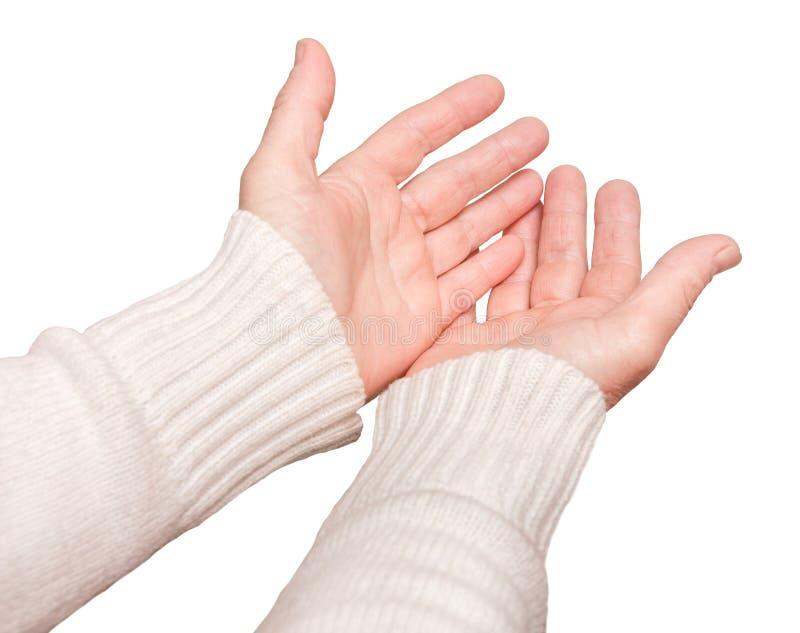 A mulher estende suas mãos para a frente na oração e no pedido, um background_ isolado branco fotografia de stock royalty free