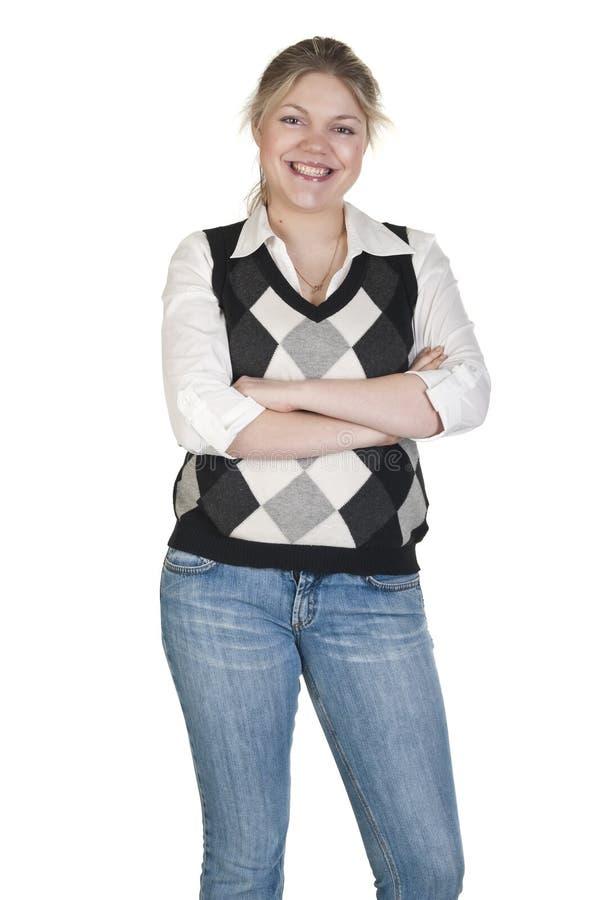Mulher executiva nova com os braços dobrados e o smili foto de stock royalty free