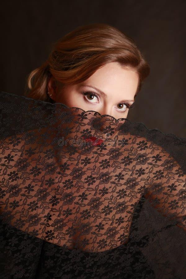 A mulher fechada por um laço imagens de stock royalty free